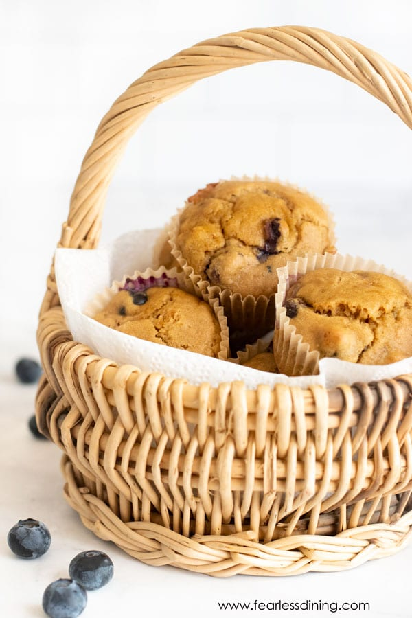 a basket of gluten free blueberry protein muffins