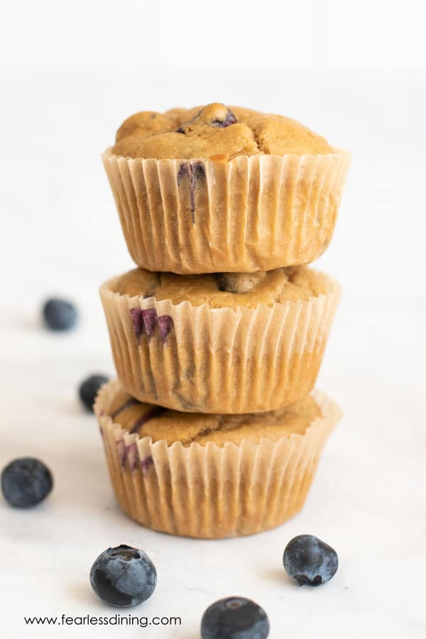 a stack of gluten free blueberry protein muffins