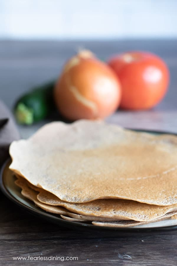 a plate stacked with teff crepes