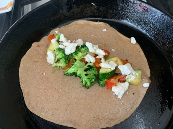 vegetables and feta cheese in the crepe