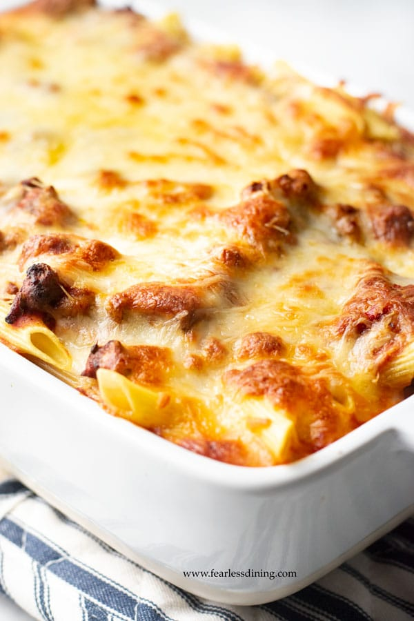 a baked gluten free ziti casserole with melted cheese