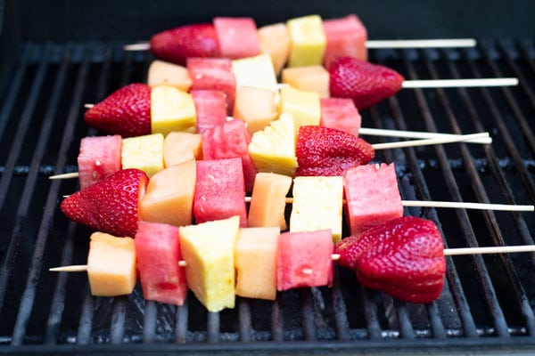 fruit kabobs on a grill