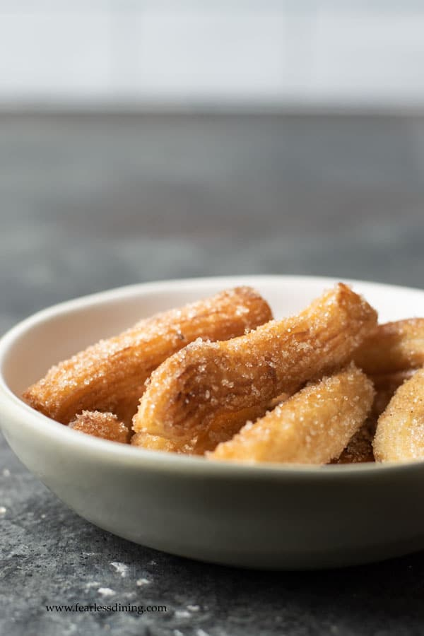 a close up of a bowl of gluten free churros