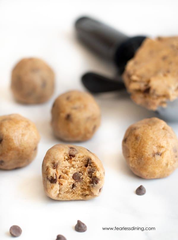 edible gluten free cookie dough balls.  one has a bite taken out