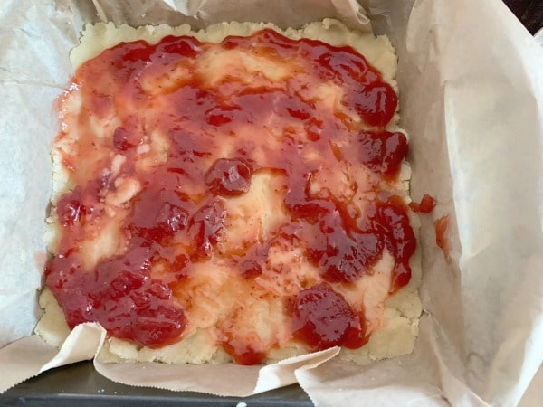strawberry jam spread on the crust