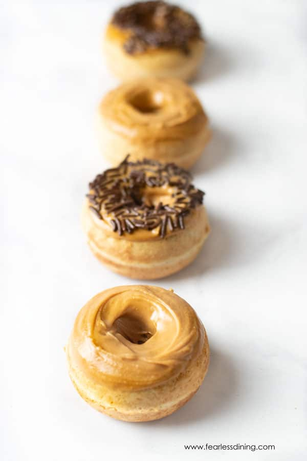 a line of gluten free peanut butter donuts