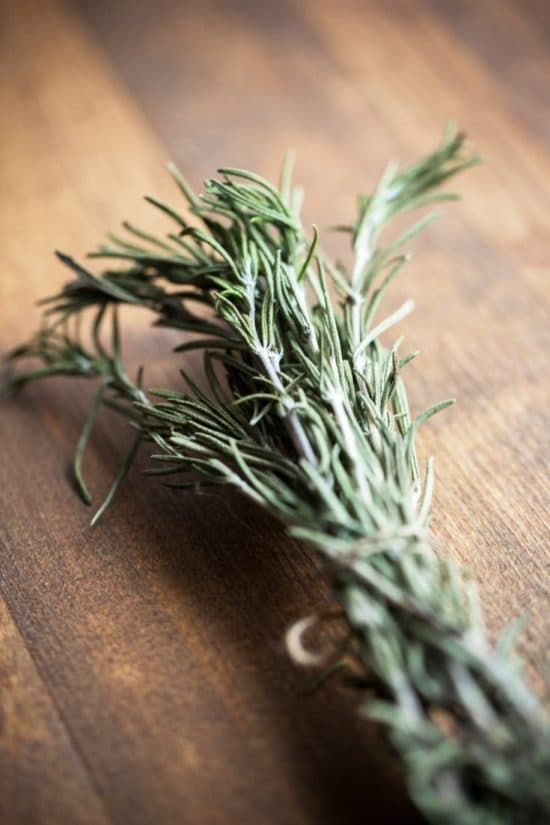 a bunch of rosemary tied with a string.