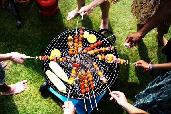 top view of vegetable skewers on a circular shaped grill