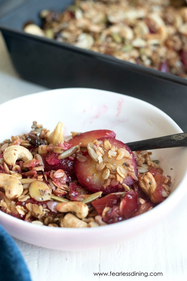 a bowl of gluten free plum crisp