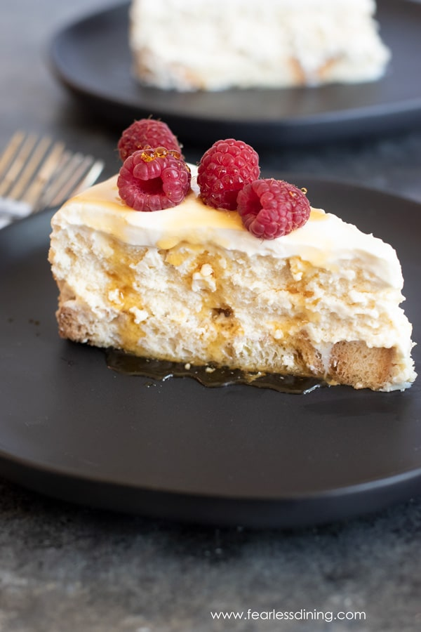 slice of gluten free French toast cheesecake with raspberries. Breakfast for dessert!!