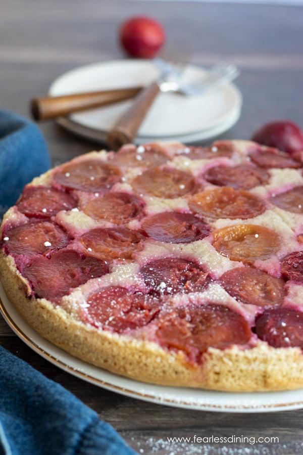 a gluten free plum upside down cake on a platter