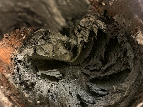 black frosting in a standing mixer