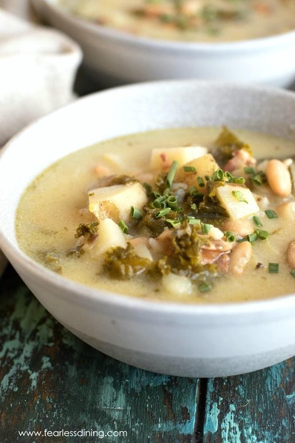 two bowls of potato kale soup