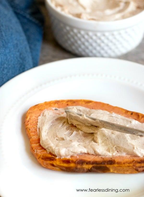 spreading schmear onto sweet potato toast.