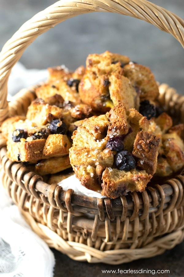 a basket of gluten free blueberry French toast muffins