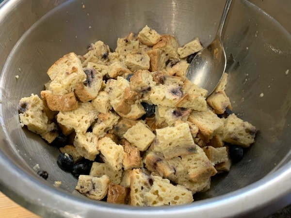 egg mixture stirred into the bread cubes