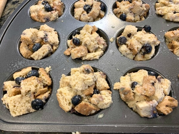 French toast muffins in a muffin tin ready to bake.