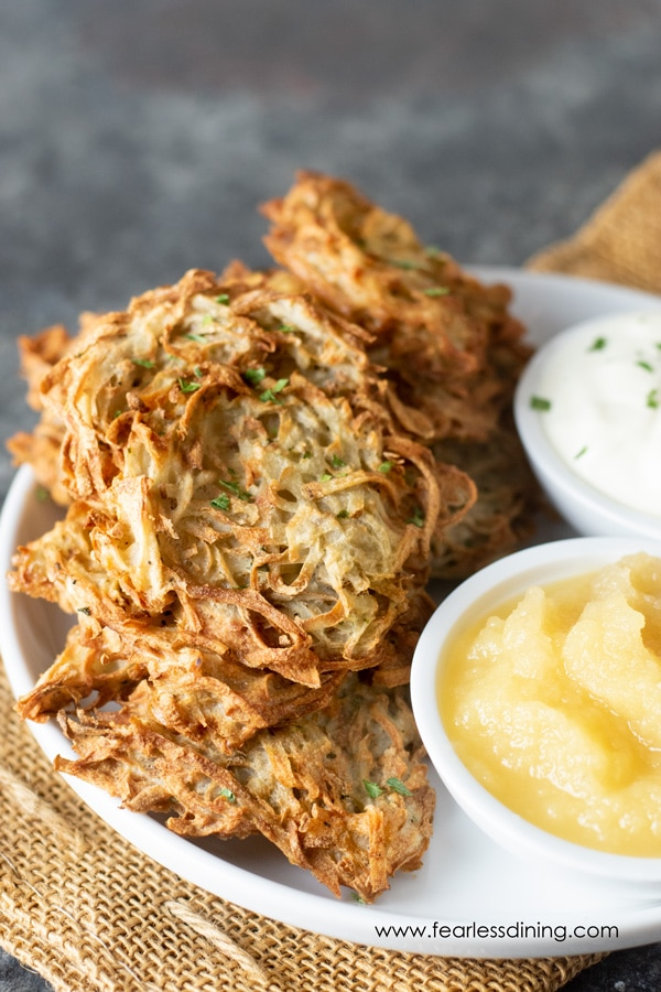 air fryer latkes on a plate with apple sauce and sour cream