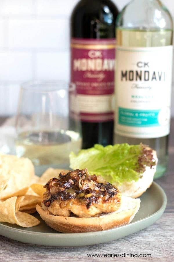 ground chicken burger with bottles of wine