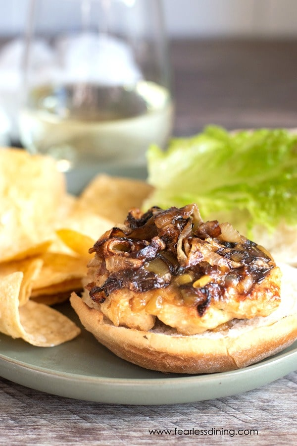 a shot of ground turkey burger topped with caramelized onions.