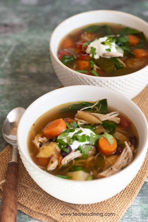 two bowls filled with healthy chicken soup