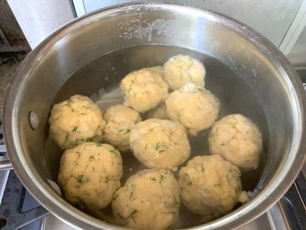 gluten free matzo balls cooking in a pot