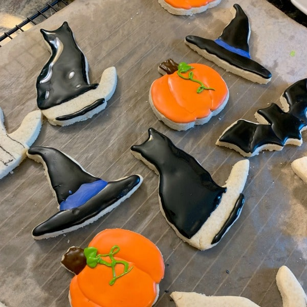 more gluten free halloween cut out cookies being decorated