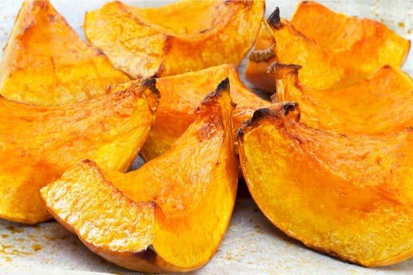 roasted pumpkin wedges on a baking sheet