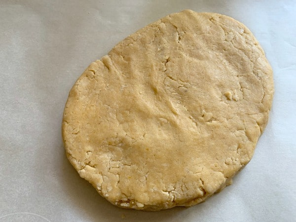 shaping the biscotti dough on a piece of parchment paper