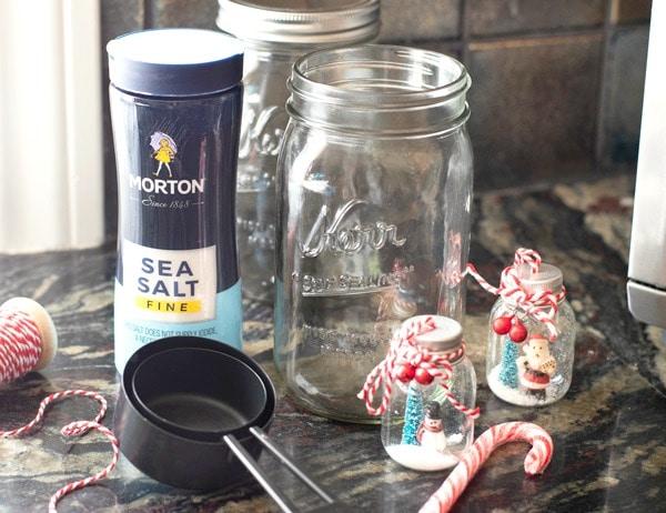Morton salt next to empty mason jars and measuring cups