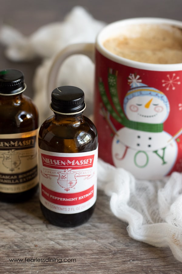 Nielsen-Massey Extracts next to a Santa coffee mug