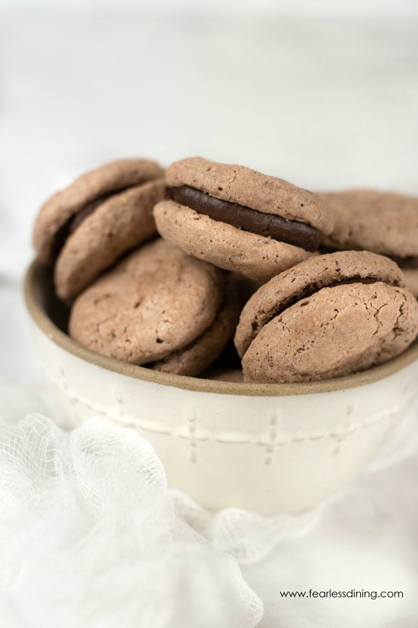 a bowl full of chocolate macarons