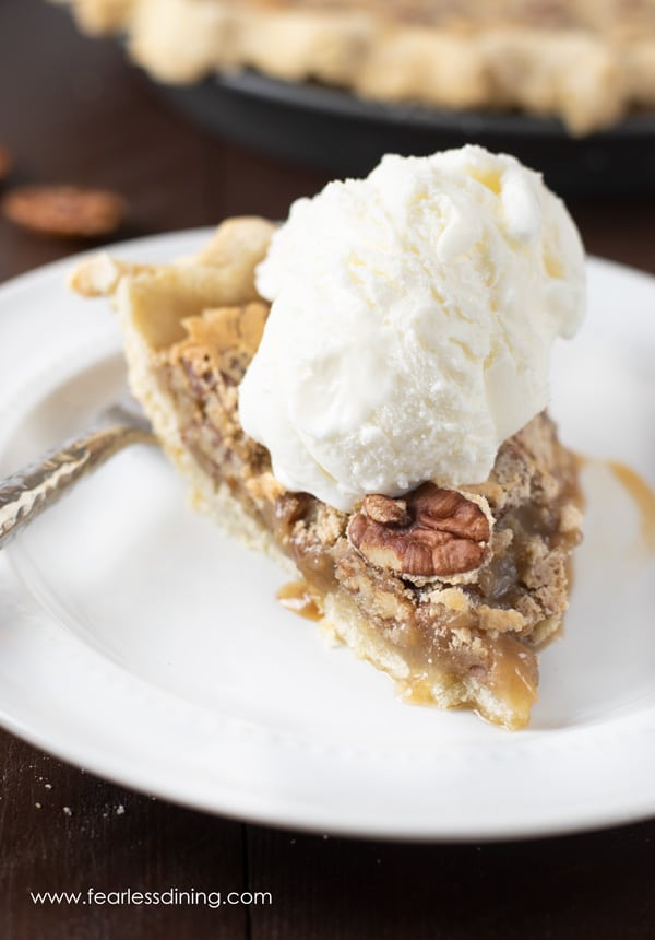 front view of a slice of gluten free pecan pie