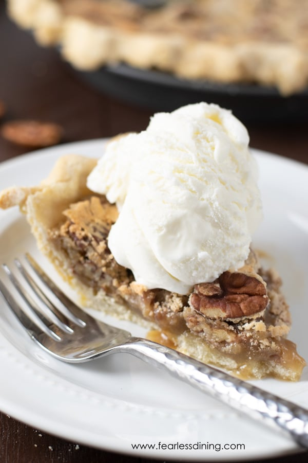 a slice of pecan pie with ice cream on top