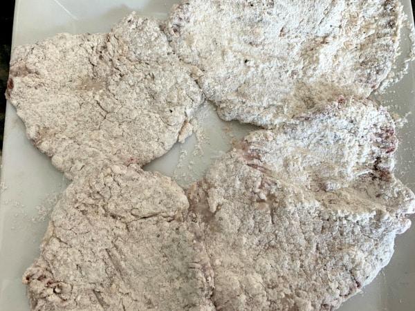 cube steak coated in flour