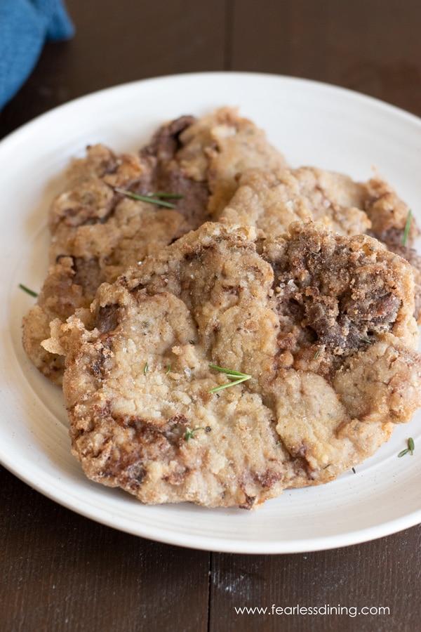 a plate of gluten free chicken fried steak pieces