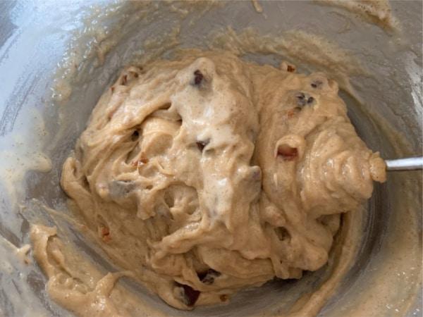 gluten free date nut cake batter in a bowl