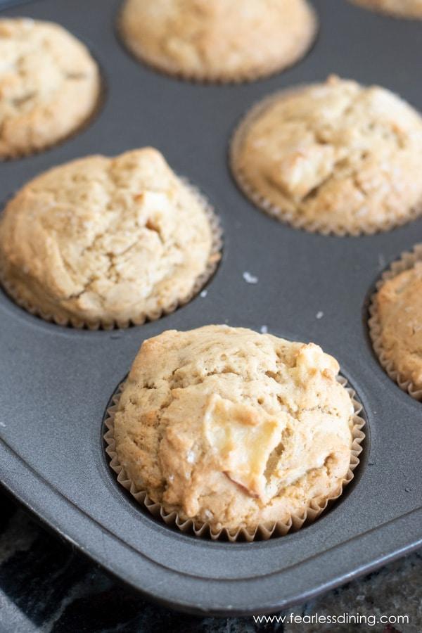 a muffin tin full of gluten free apple muffins