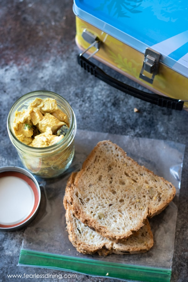 chicken curry salad in a jar with sliced bread