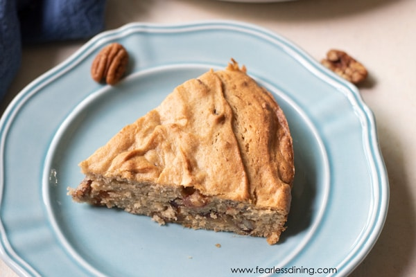 a slice of gluten free date nut cake on a plate