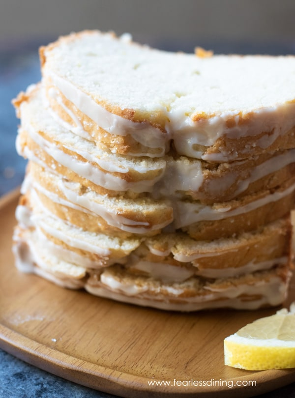 a stack of lemon cake slices on a wooden plate
