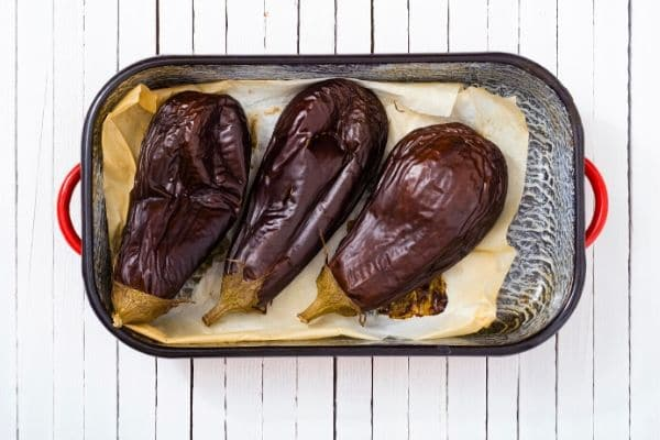 roasted eggplants in a baking dish