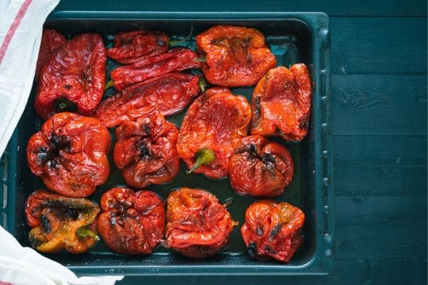 roasted red peppers in a roasting pan