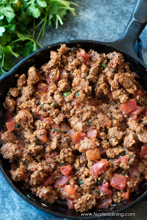 a skillet full of vegan meat filling for the casserole