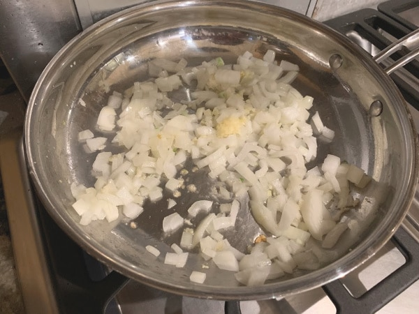 Cooking onion and garlic in a pan.