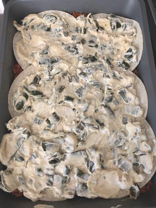 adding the poblano and cream cheese layer