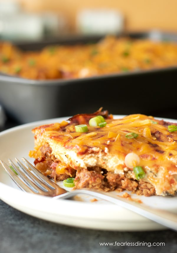 a plate with a big slice of vegan Mexican casserole
