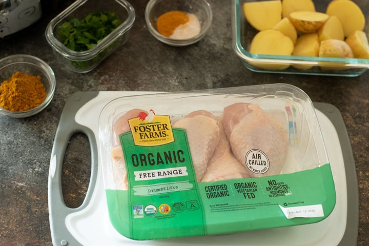 a package of chicken on a cutting board.