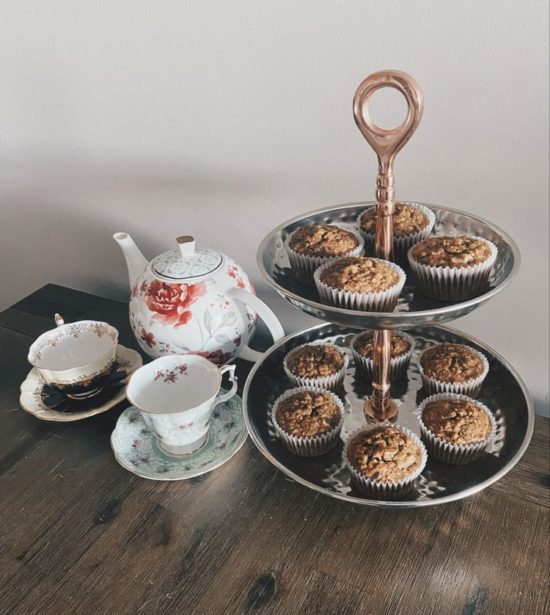 A photo Diane R sent of her muffins on a platter next to her tea set.