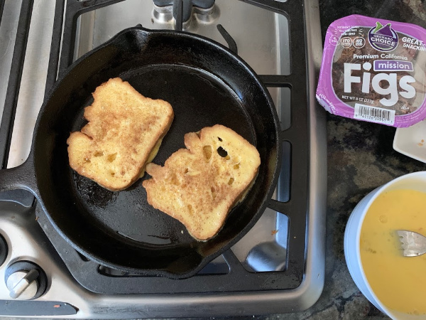 two slices of French toast in a skillet